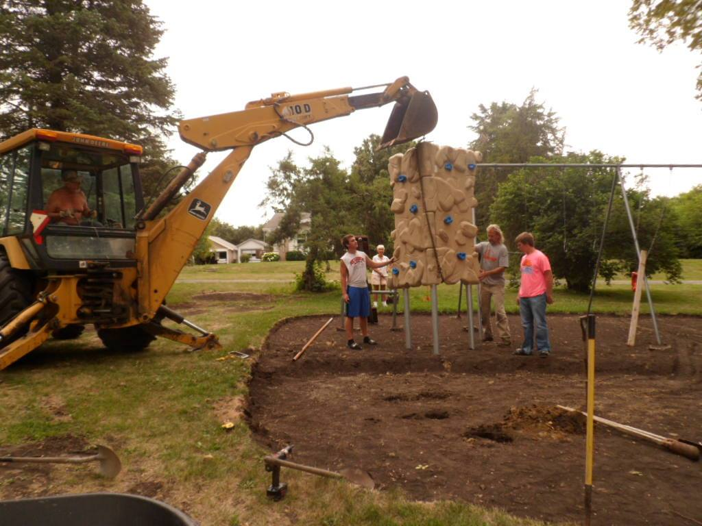 Crew installing new playground equipment at Plover City Park