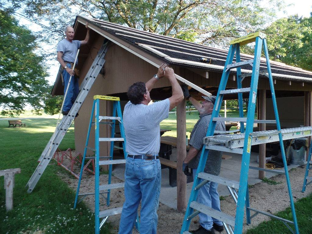 Crew installing new roof at Plover City Park