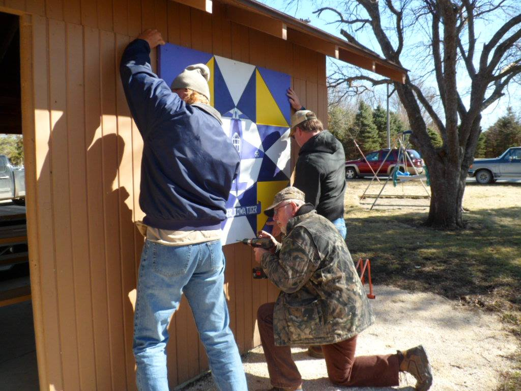 Crews installing barn quilt at Plover City Park