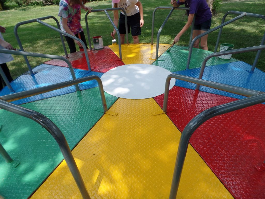 Painting playground equipment at Plover City Park