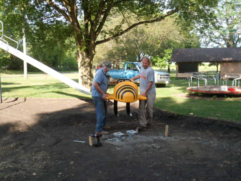 Volunteers installing new playground equipment at Plover City Park