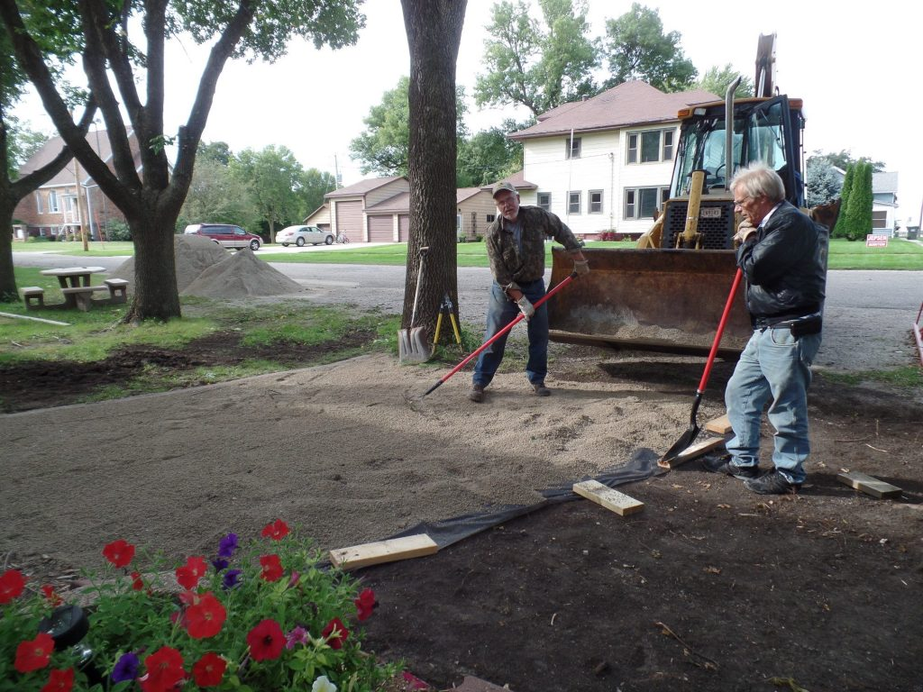 Volunteers laying gravel at Plover City hall